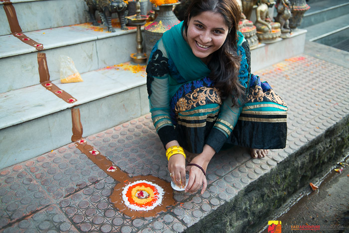 A shopkeeper gets her store ready for Lakshmi