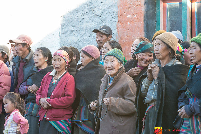 A crowd of villagers gathering for a Puja-Buddhist celebration-Lo Manthang, Nepal