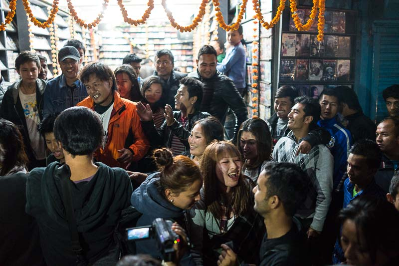A crowd dancing and celebrating Dipawali in Kathmandu's Thamel district