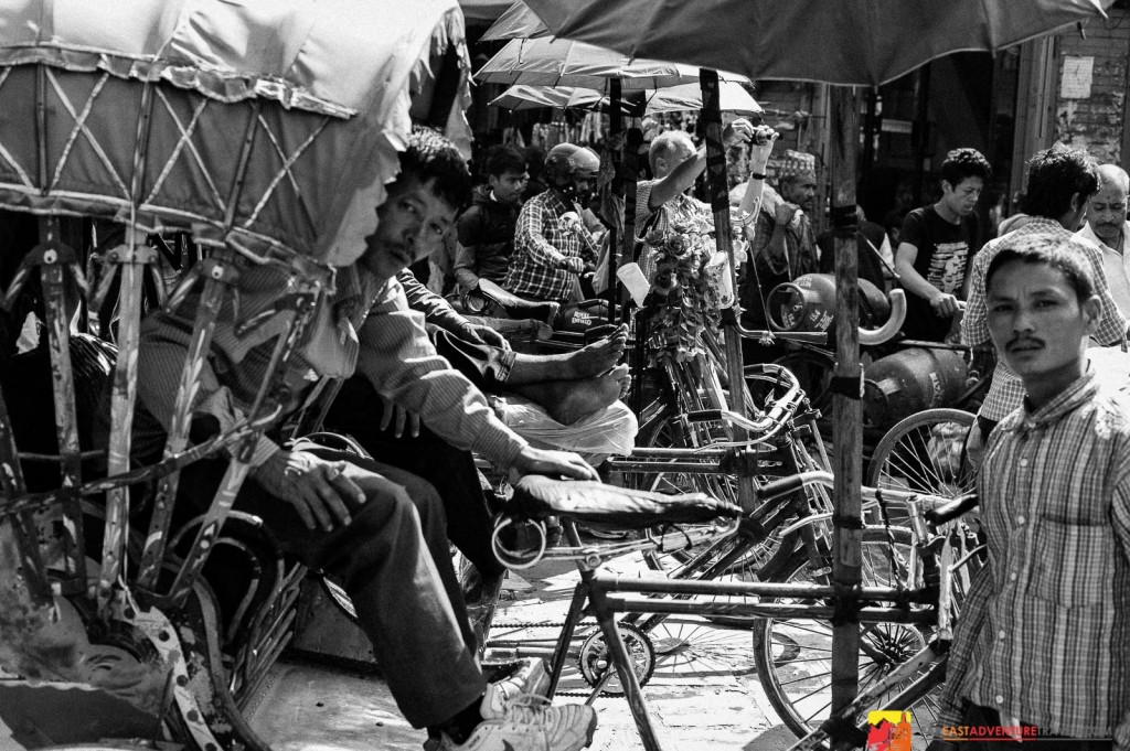 Within the traffic jumble of Thamel a group of bicycle rickshaw drivers wait for passengers-remember to bargain-their first price is usually ridiculous