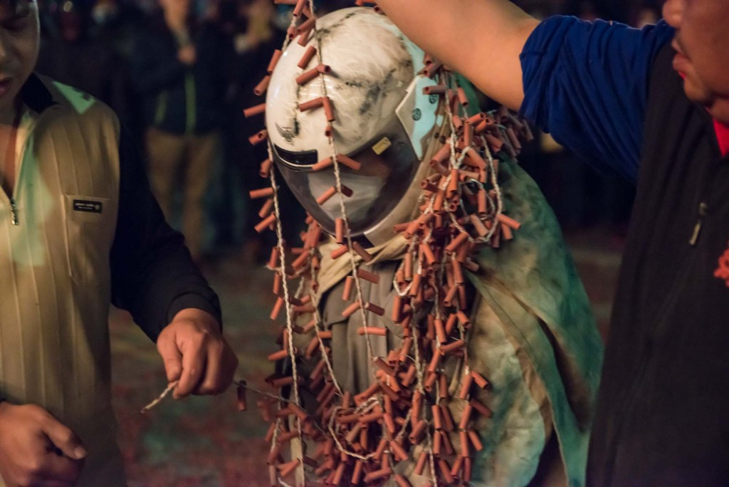 At the Yanshui Beehive Fireworks Festival held in Southern Taiwan an attendee is strung with fireworks before being lit-a way to chase away evil spirits and begin a new year with good luck