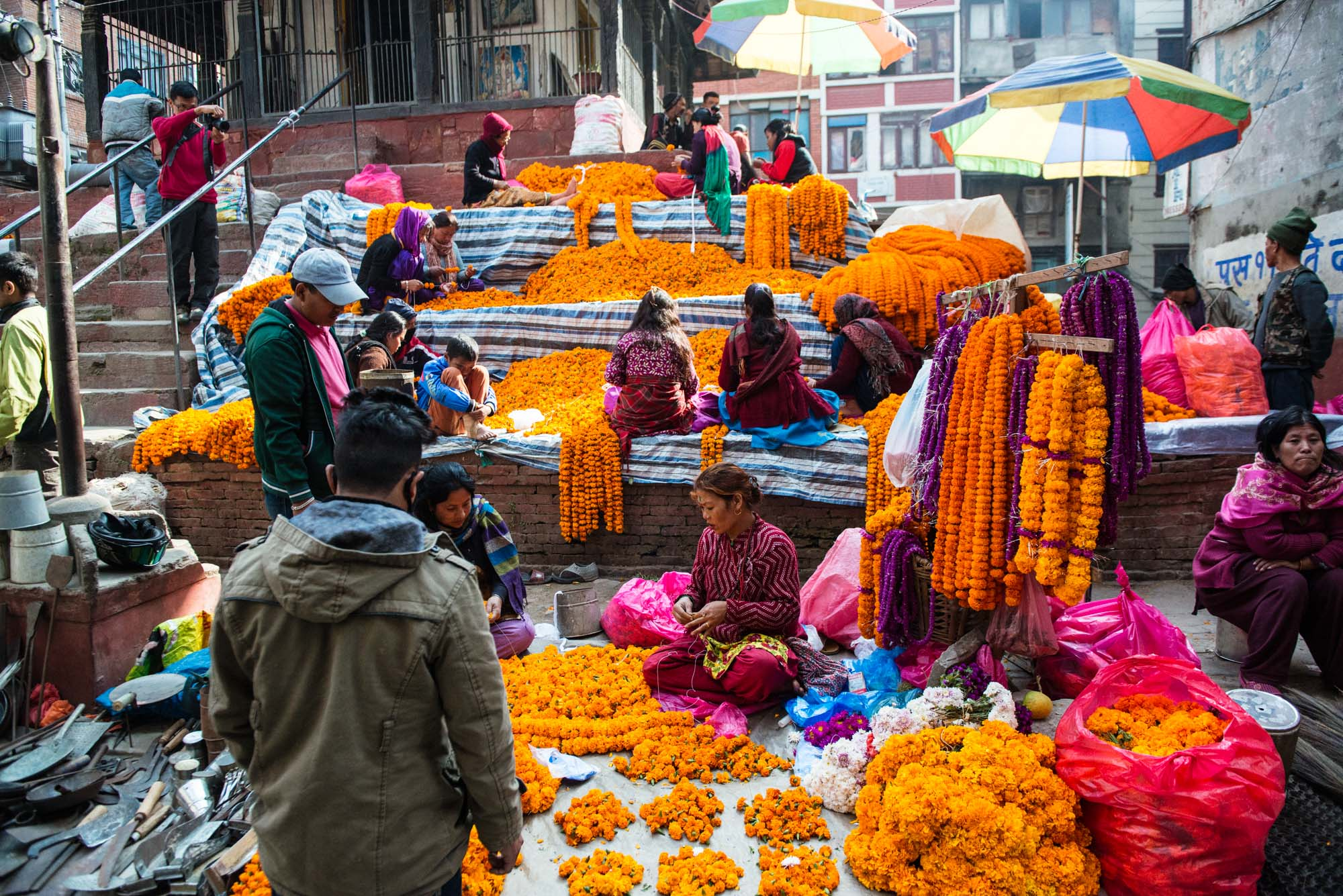 Kathmandu is at it's most colorful with the lead up to Tihar, the festival of lights-marigold garlands are available everywhere for worship and celebration. class=
