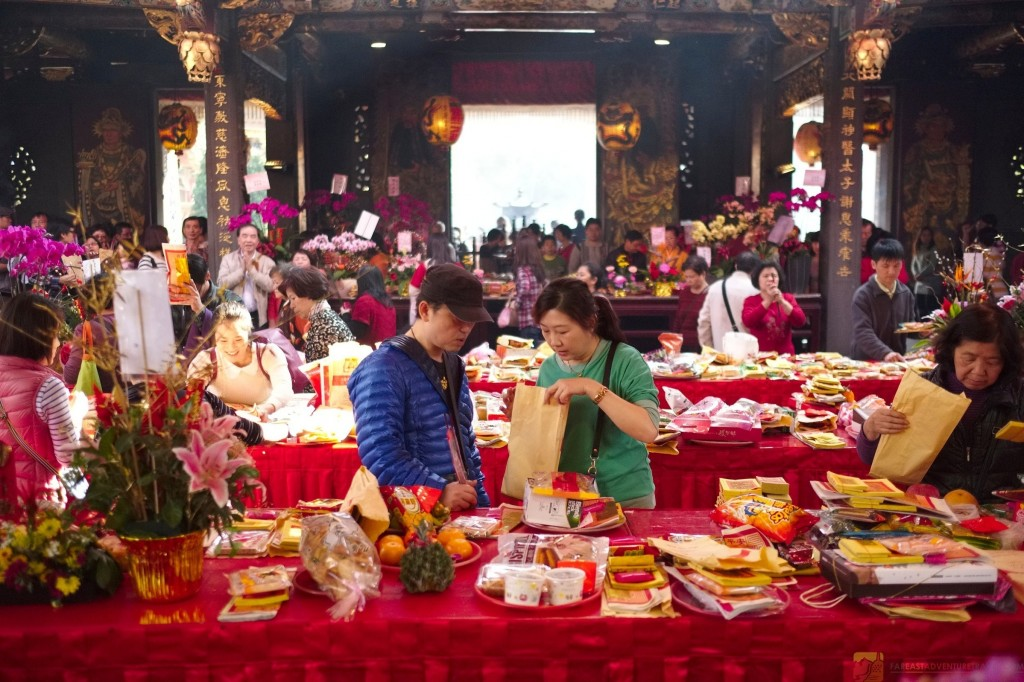 Offerings  Under The Red Awning at Baoan Temple