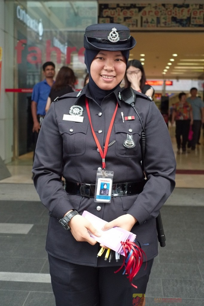 Kuala Lumpur Police Officer Distributing Cards For Messages To Victims Of Flight MH370