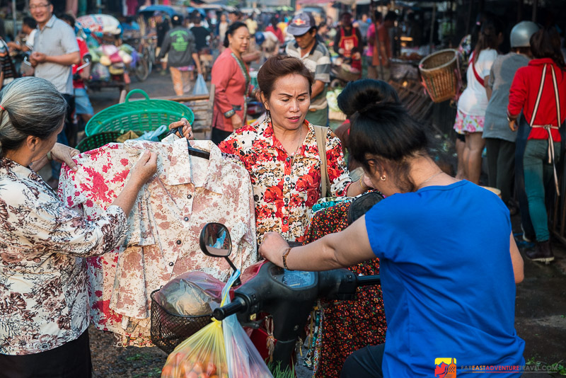 Most Household Goods And Food Were Available At The Thong Khan Kham Market-This Women Seemed To Wander The Market Selling Blouses From Her Arm