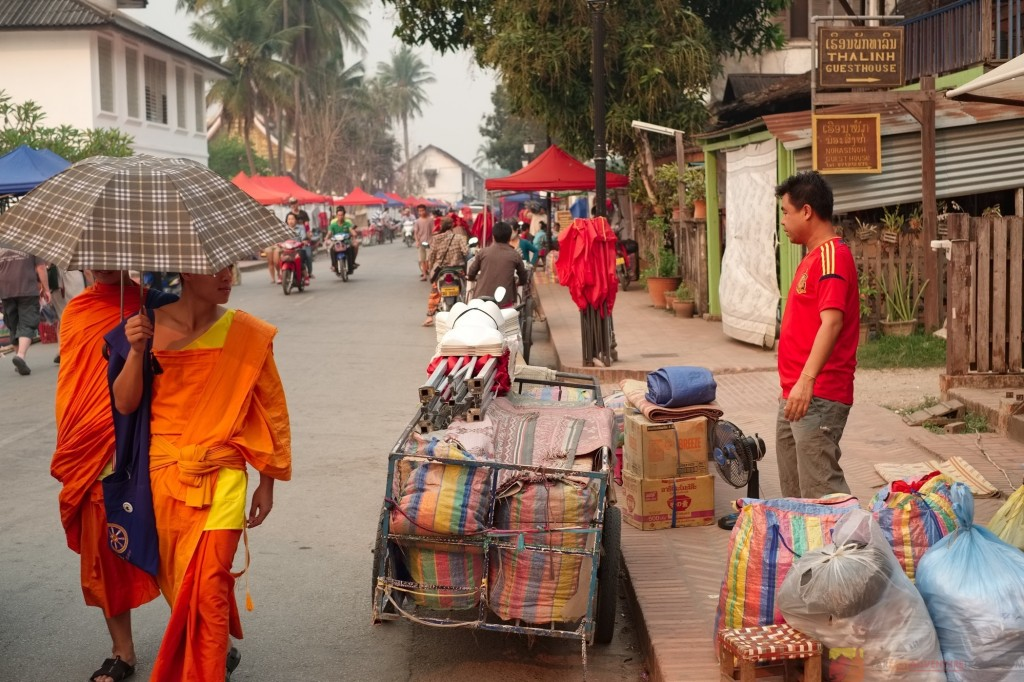 Monks strolling along the main street of Luang Prabang, Laos