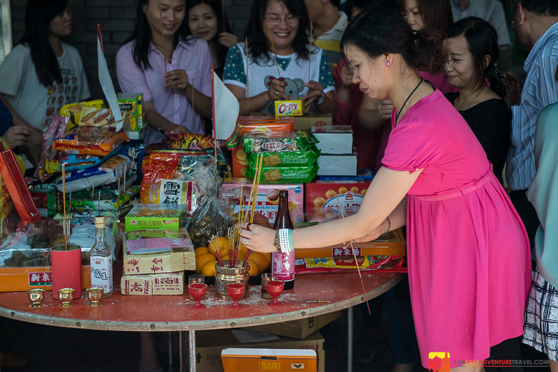 A table of food offerings for the hungry ghosts outside an office in Taipei