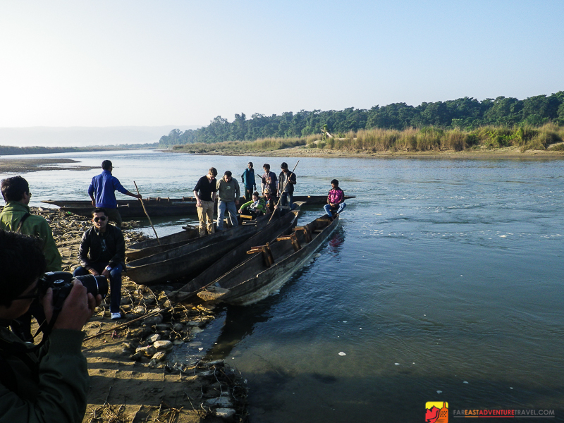Crossing the Rapti River in a dugout canoe -Chitwan National Park, Nepal