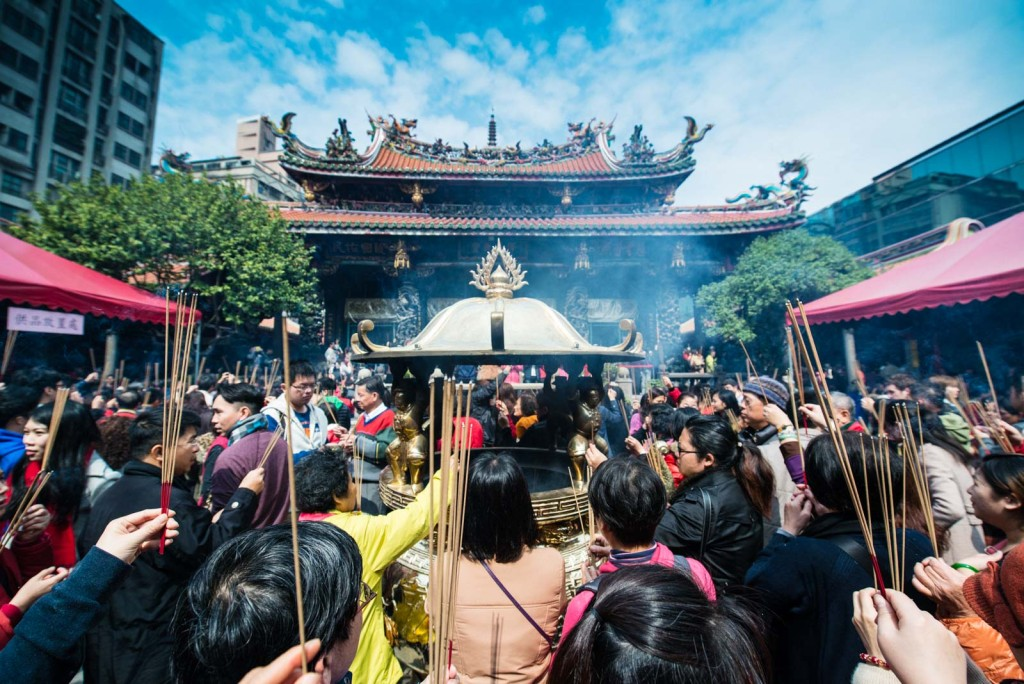 Longshan Temple-Taipei, Taiwan-thousands of worshippers praying on the first day of The Lunar New Year