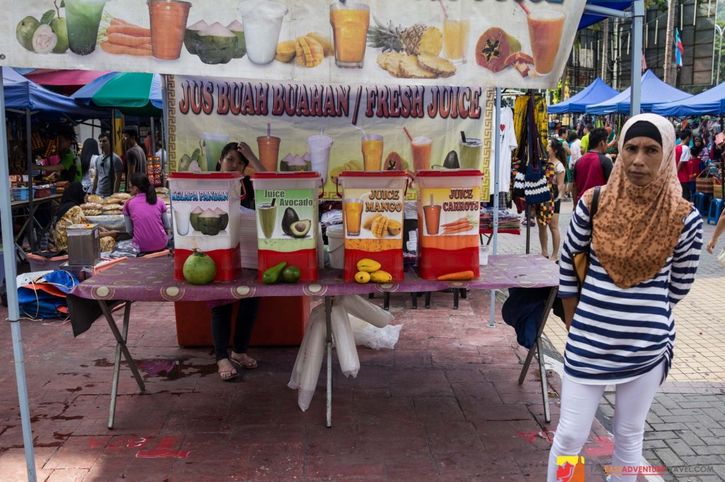 A juice vendor at the Gaya Street Market held every Sunday in Kota Kinabalu, Malaysian Borneo