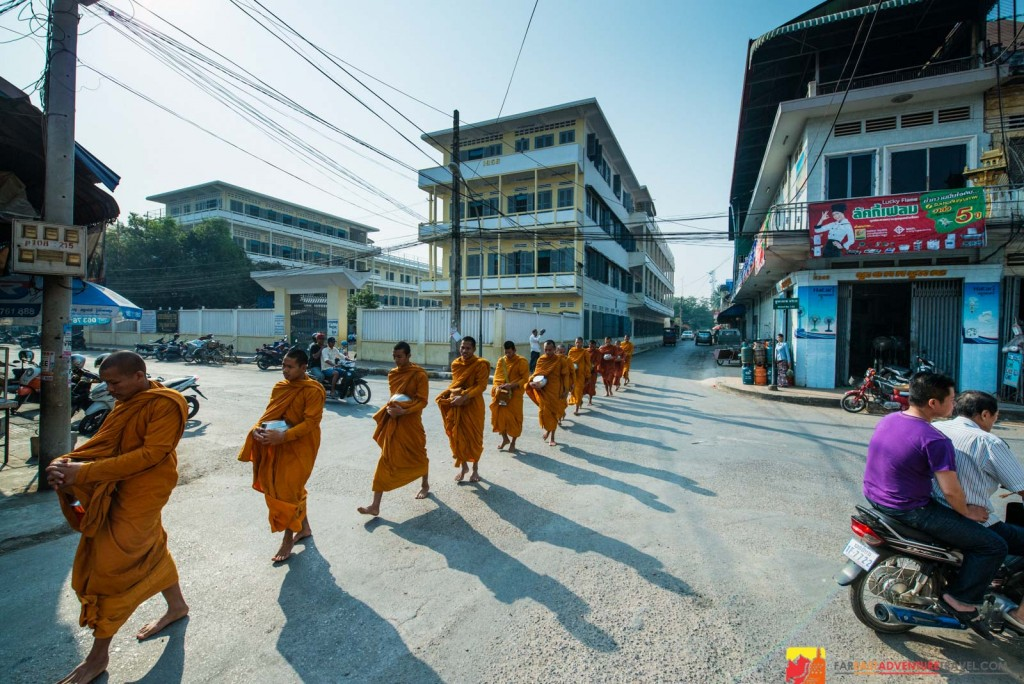Buddhist monks in their morning alms of offering lay people a chance to give and receive blessings-Battambang, Cambodia