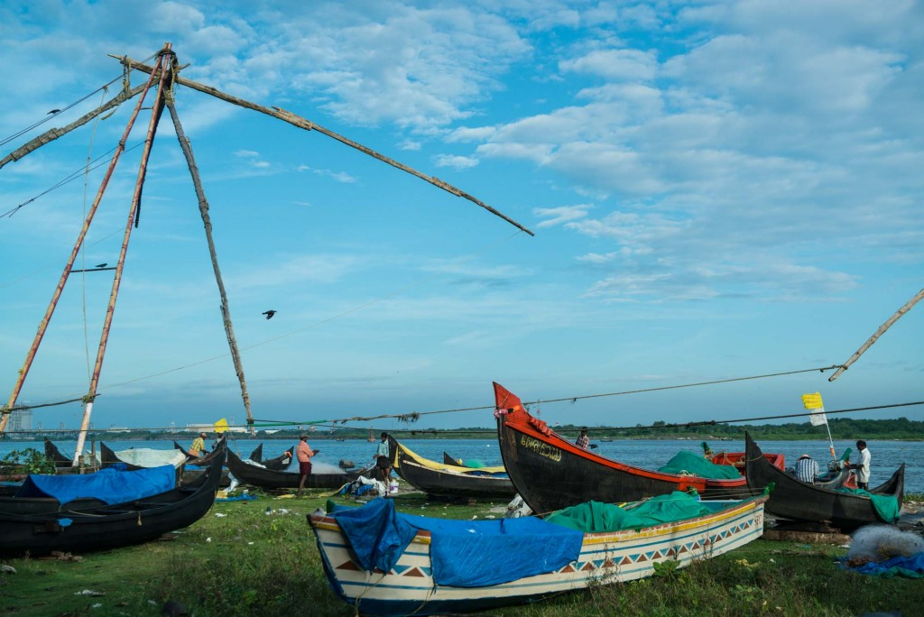 An ancient Chinese fishing net and traditional fishing boats are still used to catch a variety of fish and creatures from the sea in Fort Cochin-Kerala, India