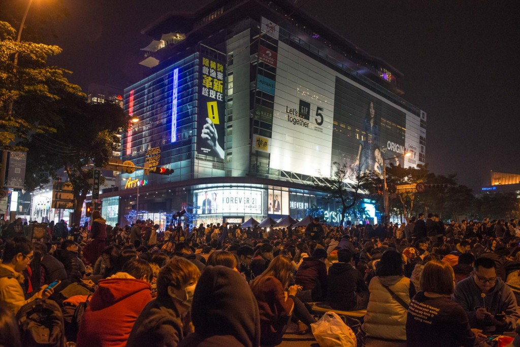 Crowds gather in the Xinyi Shopping District of Taipei, Taiwan for the annual Taipei 101New Years Eve fireworks celebration